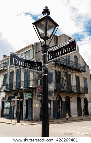 New Orleans, LA USA - April 20, 2016: Intersection of Bourbon and Dumaine Street in the historic district of the French Quarter.