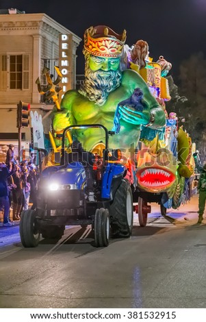 New Orleans, LA/USA - circa February 2016: Krewe of Title in parade during Mardi Gras in New Orleans, Louisiana - stock photo