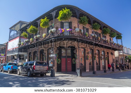 New Orleans, LA/USA - circa February 2016: Old Colonial House with ironwork galleries on the Streets of French Quarter decorated for Mardi Gras in New Orleans, Louisiana - stock photo