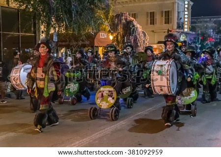 New Orleans, LA/USA - circa February 2016: People dressed in costumes during Mardi Gras parade in New Orleans, Louisiana - stock photo