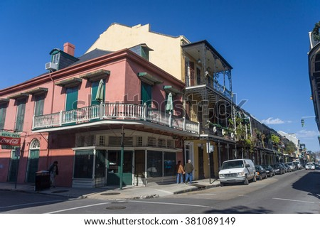 New Orleans, LA/USA - circa January 2008: Old Colonial House with ironwork galleries on the Streets of French Quarter decorated for Mardi Gras in New Orleans, Louisiana - stock photo