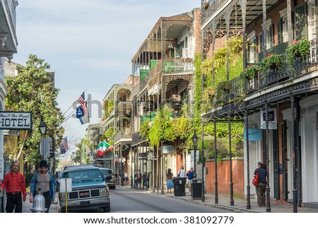 New Orleans, LA/USA - circa March 2009: Old Colonial Houses with ironwork galleries on the Streets of French Quarter decorated for Mardi Gras in New Orleans, Louisiana - stock photo