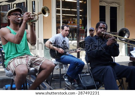 NEW ORLEANS,LA/USA - 3-21-2014: New Orleans French Quarter street musicians playing an impromptu performance near Bourbon Street                            - stock photo