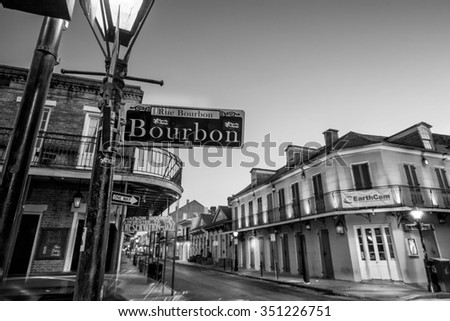 NEW ORLEANS, LOUISIANA - AUGUST 25: Bourbon Street sign with pubs and bars and neon lights  in the French Quarter, New Orleans on August 25, 2015.  - stock photo