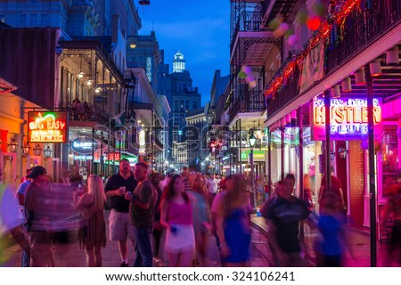 NEW ORLEANS, LOUISIANA - AUGUST 21: Pubs and bars with neon lights  in the French Quarter, downtown New Orleans on August 21, 2015.  - stock photo