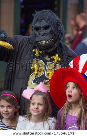 NEW ORLEANS, LOUISIANA- JANUARY 18, 2014:  Mardi Gras celebrants party on Bourbon Street in the French Quarter of New Orleans. - stock photo