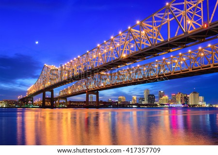 New Orleans, Louisiana, USA at Crescent City Connection Bridge over the Mississippi River. - stock photo