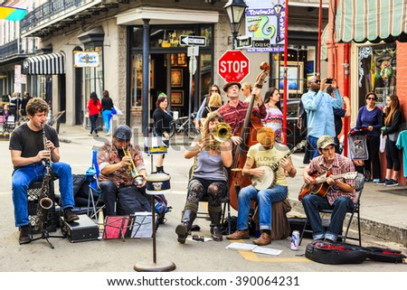 NEW ORLEANS, LOUISIANA USA- FEB 2 2016: An unidentified  local jazz band performs  in the New Orleans French Quarter on, to the delight of visitors in town  - stock photo