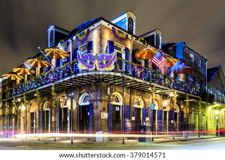 NEW ORLEANS, LOUISIANA USA- JAN 23 2016: Pubs and Bars having colorful lights and decorations in the French Quarter. Tourism provides a much needed financial source,  also home for great musicians.  - stock photo