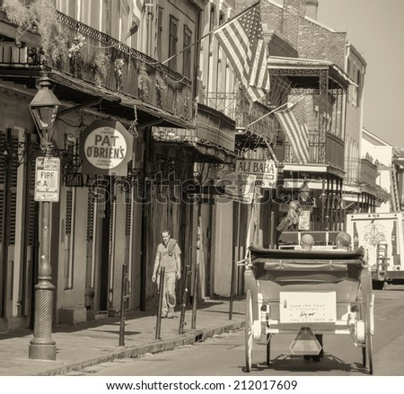 NEW ORLEANS - MARCH 7, 2009: City streets and flags on a beautiful sunny day. New Orleans is visited by almost 9 million people every year. - stock photo
