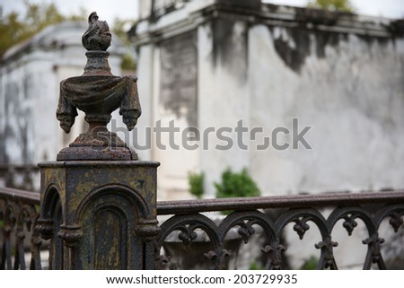 New Orleans Saint Louis Cemetery.  Old and rusty wrought iron corner post and fence.  Copy space in upper right if needed. - stock photo