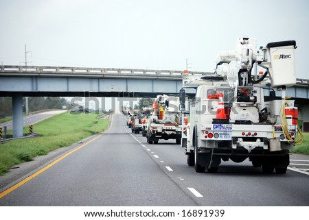 NEW ORLEANS - SEPT 2: A convoy of repair vehicles move along the I-10 freeway towards Baton Rouge in the aftermath of Hurricane Gustav on September 2, 2008 near New Orleans.