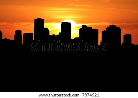 New Orleans skyline at sunset with beautiful sky - stock photo