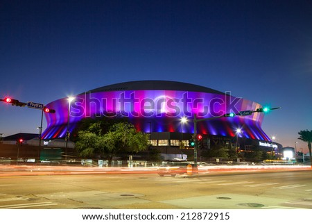 New Orleans, USA - January 23rd: New Orleans Superdome lit up at night just days before the 2013 Superbowl - stock photo