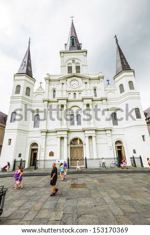 NEW ORLEANS, USA - JULY 15: famous St, Louis cathedral at Jackson Square, in the  French Quarter on July 15, 2013 in New Orleans, USA. Three Roman Catholic churches have stood on the site since 1718. - stock photo