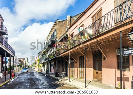 NEW ORLEANS, USA - JULY 17, 2013: historic building in the French Quarter in New Orleans, USA. Tourism provides a large source of revenue after the 2005 devastation of Hurricane Katrina. - stock photo