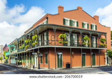 NEW ORLEANS,  USA - JULY 17, 2013: houses in historic building in the French Quarter in New Orleans, USA. Tourism provides a large source of revenue after the 2005 devastation of Hurricane Katrina. - stock photo