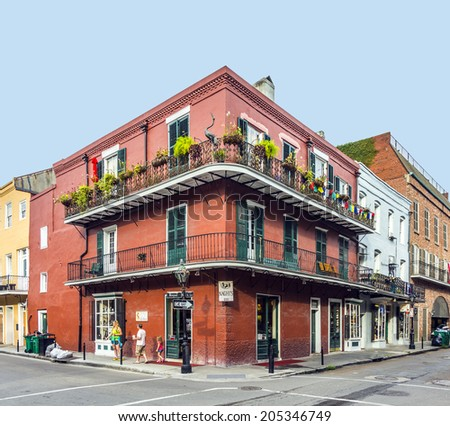 NEW ORLEANS, USA - JULY 16, 2013: people visit historic building in the French Quarter in New Orleans, USA. Tourism provides a large source of revenue after the 2005 devastation of Hurricane Katrina. - stock photo