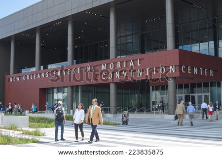 NEW ORLEANS, USA - OCTOBER 12, 2014: Attendees and exhibitors roam in front of the New Orleans Ernest N. Morial Convention Center at the annual meeting of the American Society of Anesthesiologists. - stock photo