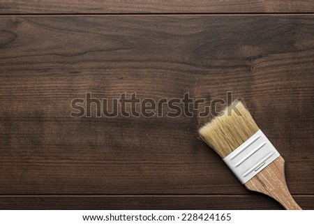 new paint brush on the brown wooden table background - stock photo