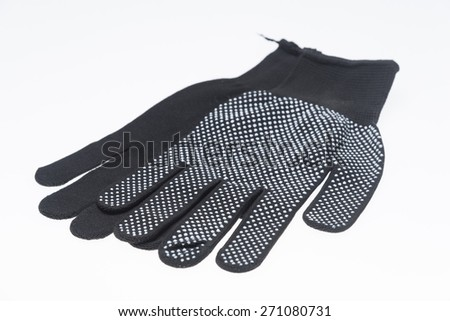 New Pair of Black Knit Gloves with Pattern on white background - stock photo