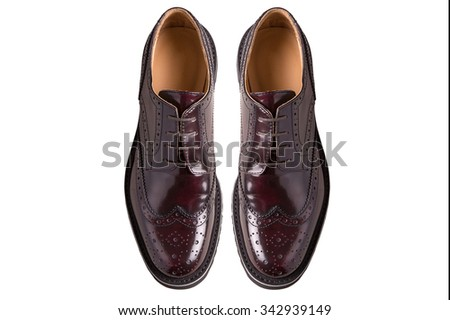 New pair of man brogues shoes on a gray background.