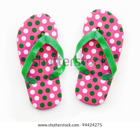 New pair of pink / green polka dots flip flops isolated on white background - stock photo