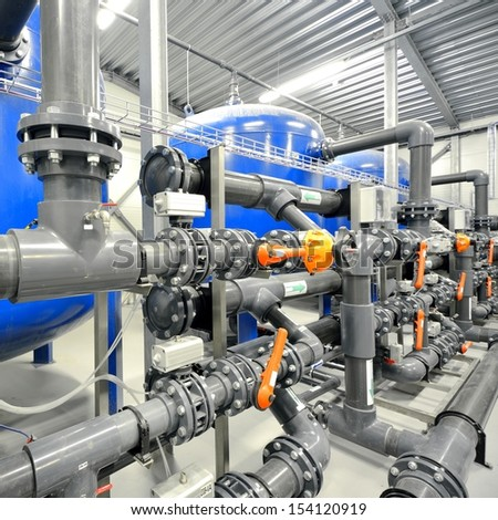 new plastic pipes and colorful equipment in industrial boiler ro - stock photo