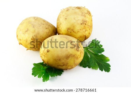 New potato and green parsley isolated on white background - stock photo