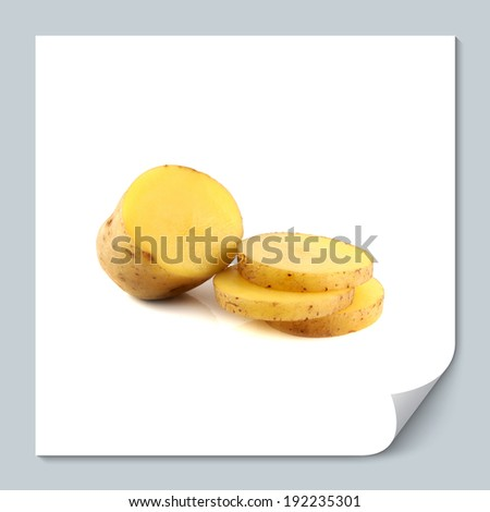 New potato half with slices isolated on white background - stock photo