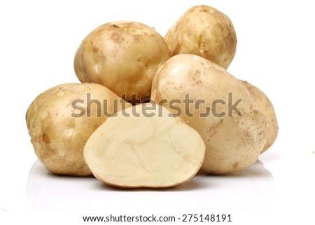 New potato isolated on white background  - stock photo