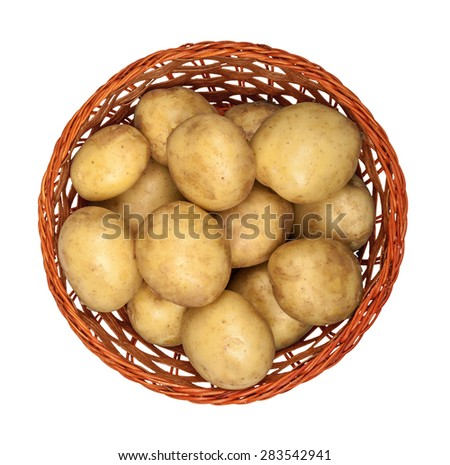 new potatoes in a basket on an isolated white background. view from above - stock photo