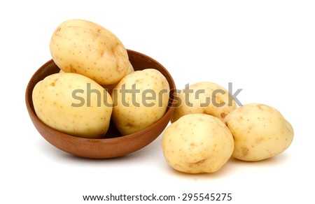new potatoes in bowl isolated on white  - stock photo