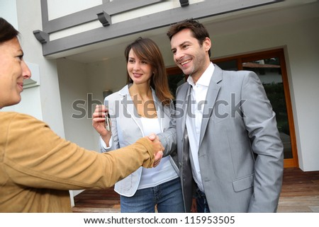 New property owners shaking hands to sales agent - stock photo