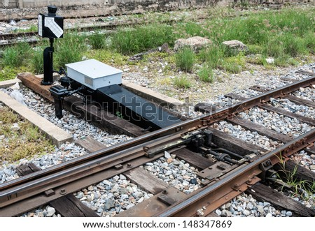 New railroad switch in the urban station of Thailand. - stock photo
