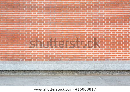 New red bricks wall with stone floor and empty bench - stock photo