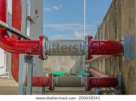 new red pipe in energy system of factory - stock photo