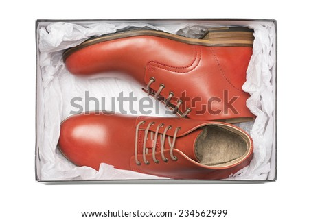 new red shoes in box with wrapping paper - stock photo