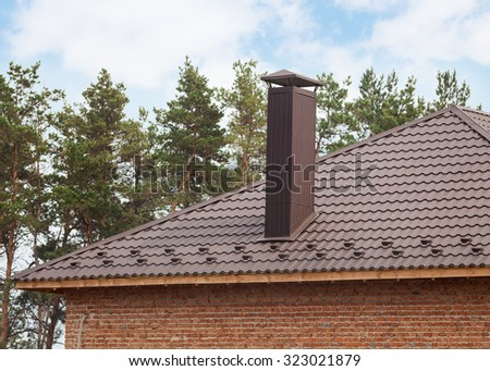 New red tiled Roof with chimney - stock photo