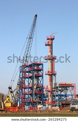 new refinery construction site with machinery - stock photo