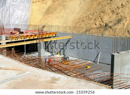 new reinforcement being made in a foundation trench - stock photo