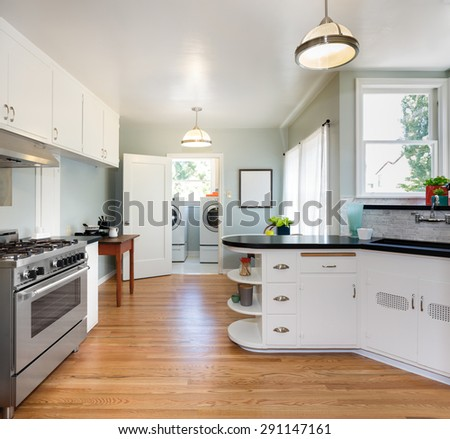 New remodeled kitchen with wooden floor, stainless steel oven / stove  - stock photo