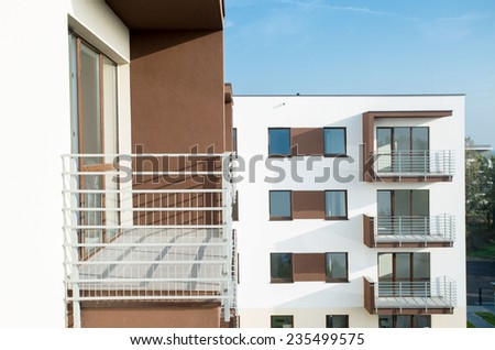 New residential block on sunny summer day - stock photo