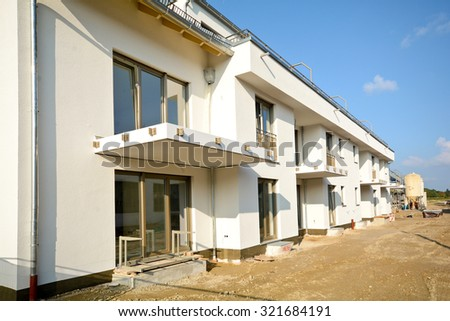 New residential buildings with outdoor facilities - Construction work near completion - stock photo