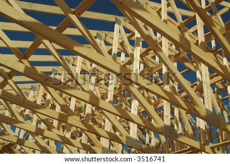 New residential construction home framing. - stock photo