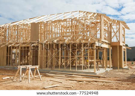 New residential construction home framing.Construction site - stock photo