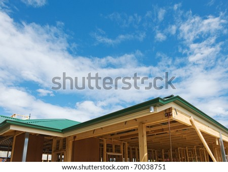 New residential construction home framing with roof view - stock photo