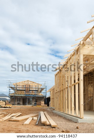 New residential construction home wooden framing against a blue sky - stock photo