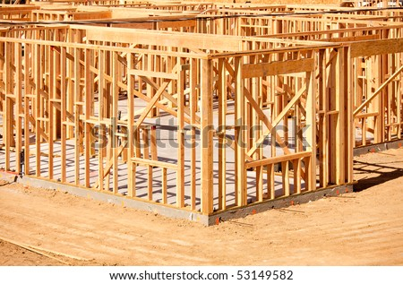New Residential Home Construction Framing Site Just Before the Roofing Phase. - stock photo