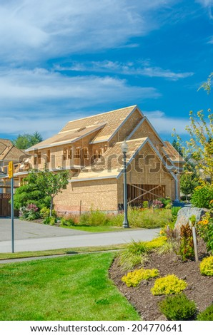 New residential home under construction, framing. North America. - stock photo